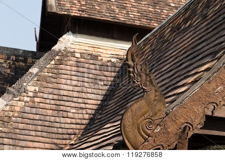 Wooden Naga Sculpture On Ancient Buddhism Temple Roof