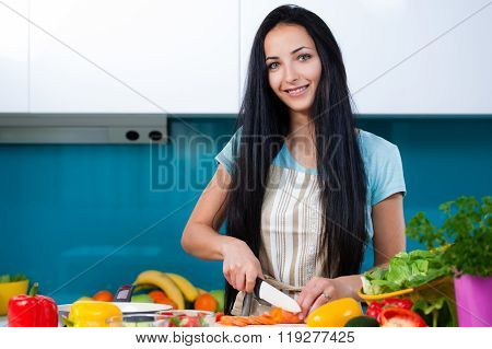 Woman cooking in the kitchen healthy food