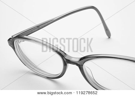 Female Eyeglasses Macro Detail Over A White Background.