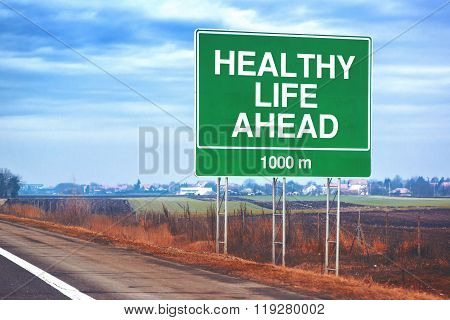 Healthy Life Ahead Traffic Sign At Roadside
