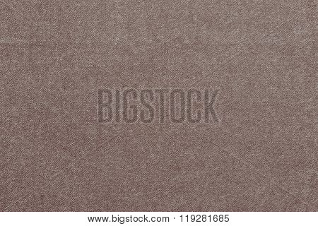 Speckled Textured Monochrome Background From Fabric Of Pale Brown Color