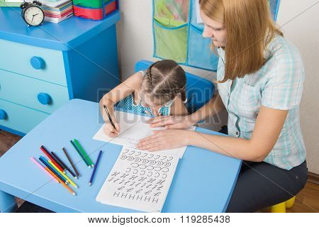 Mentor And Five Year Old Child Learning Spelling