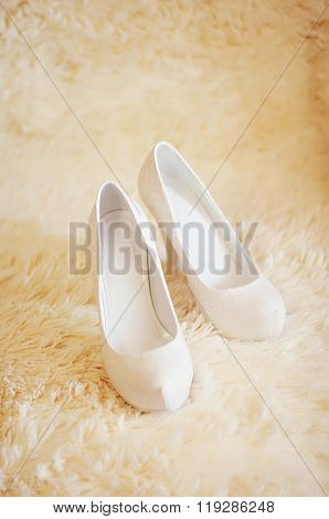 Cute stylish beige high heels  on the background room, glamor, f