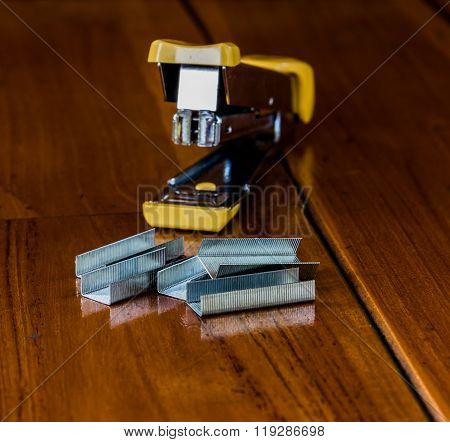 Stapler Is On The Wood.