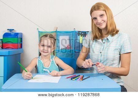 The Five-year Child Draws On A Sheet Of Paper, Pencils Undermines Mom