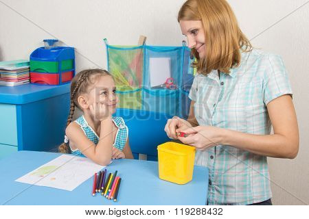 The Five-year Child And Mother That Sharpens Pencils Looked At Each Other