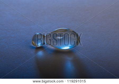 Gel capsule illuminated with blue lighting