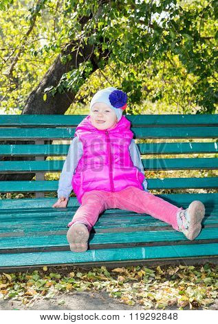 Adorable Little Child Girl At Fall. Use It For Baby, Parenting Or Love Concept