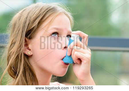 Pretty Girl Using Asthma Inhaler