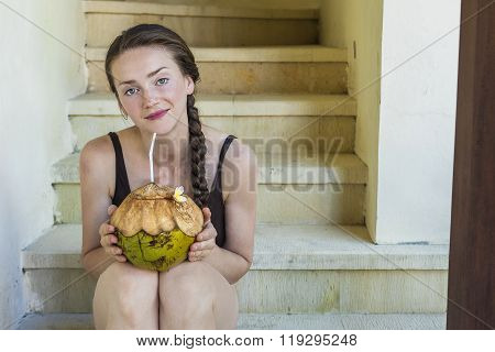 Young Woman Sipping On A Fresh Coconut