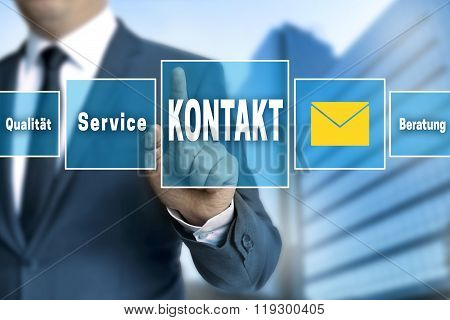 Contact (in German Language Kontakt) Touchscreen Is Operated By Businessman