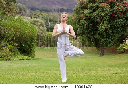 Yoga Woman Standing On One Leg In Nature