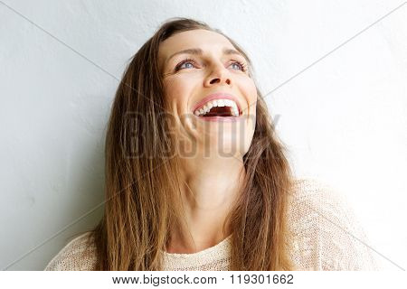 Beautiful Middle Aged Woman Laughing Against White Background