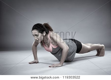 Athletic Girl Doing Pushups
