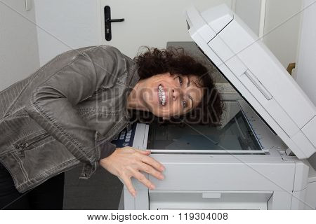 Irritated  Business Woman Looking At  Printer At Office