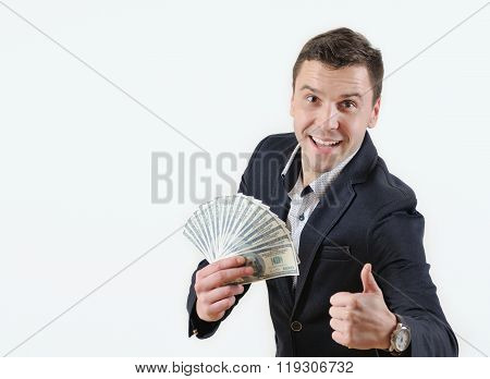 Businessman With Wad Of Money  In Studio On A White Background