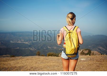 Female wanderer enjoying beautiful landscape