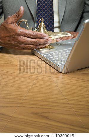 Man rubbing genie lamp
