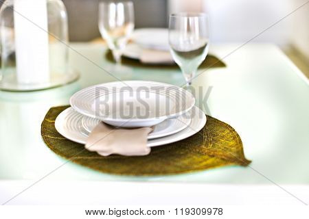 Empty Plates On A Leaf Design And Glass With The Table Set Up