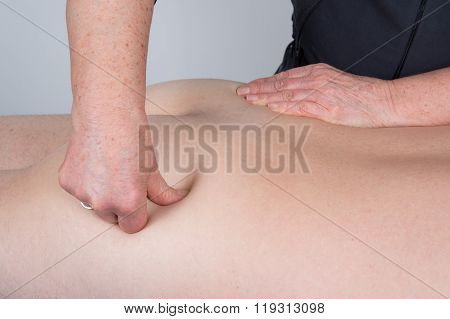 Massaging The Acupressure Points On The Men's Buttocks