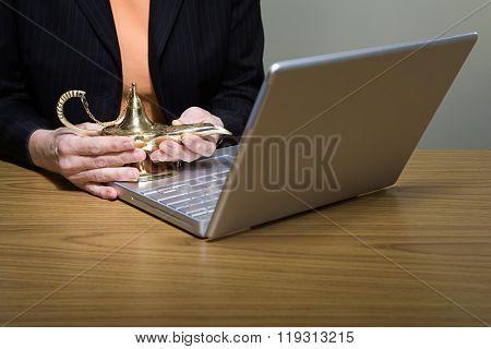 Woman rubbing genie lamp