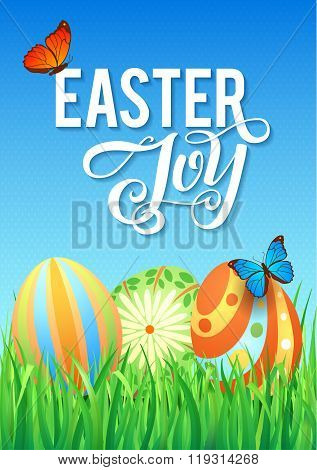 Easter eggs in Fresh Green Grass. Decorated Easter Eggs in Grass on Sky Background. Happy Easter Cal