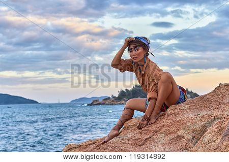 Asian woman, bright makeup, boho style, ethnic fashion, near sea.