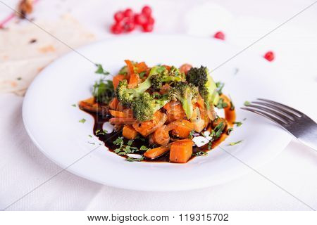 Autumn vegetables with rice steamed with a dark sauce.