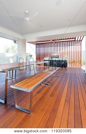 Table And Benches With A Floor Made Of Long Wooden Bars