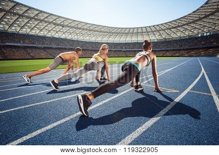 Young sporty people at large modern stadium