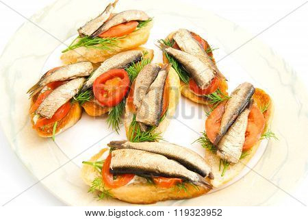 Sandwiches With Sprats On A Dish On White
