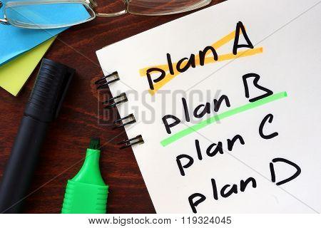 Cross plan A, underline plan B concept  written in a notebook.