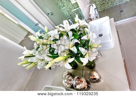 Bunch Of White Flowers And Buds Against To The Mirror On The Gray Color Workshop Near To The Sink In