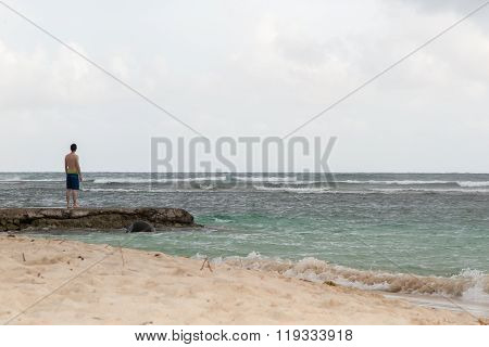 Man Looking At The Sea Under Blue Sky