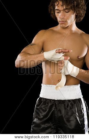 Boxer tying bandage