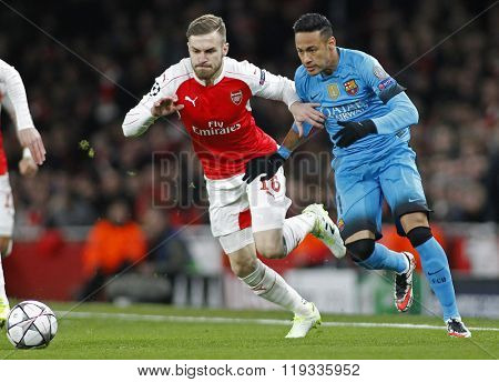 LONDON, ENGLAND - FEBRUARY 23: Aaron Ramsey of Arsenal and Neymar of Barcelona during the Champions League match between Arsenal and Barcelona at The Emirates Stadium