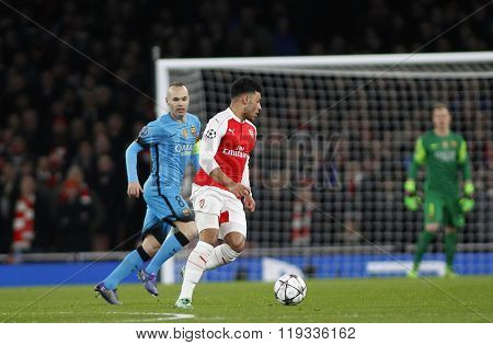 LONDON, ENGLAND - FEBRUARY 23: Andres Iniesta of Barcelona and Alex Oxlade-Chamberlain of Arsenal during the Champions League match between Arsenal and Barcelona at The Emirates Stadium