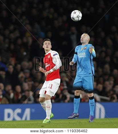 LONDON, ENGLAND - FEBRUARY 23: Mesut Ozil of Arsenaland Andres Iniesta of Barcelona during the Champions League match between Arsenal and Barcelona at The Emirates Stadium