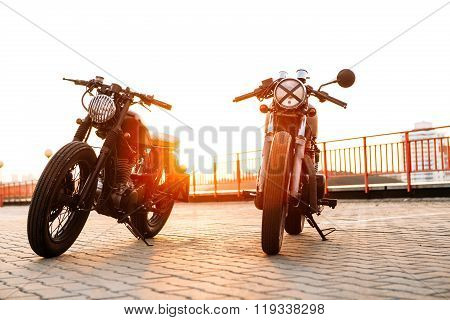 Two Black And Silver Vintage Custom Motorcycles Caferacers