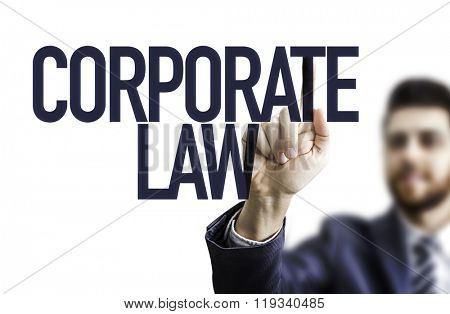 Business man pointing the text: Corporate Law