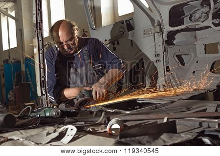 Portrait Of An Elderly Mechanic