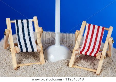 Island With Toy Deckchair And Parasol