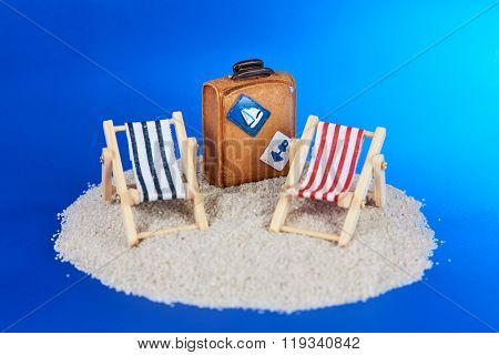 Toy Island With Deckchairs And Suitcase