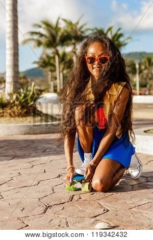 Beautiful Teenage Black Girl In Blue Skirt With Her Penny Longboard.