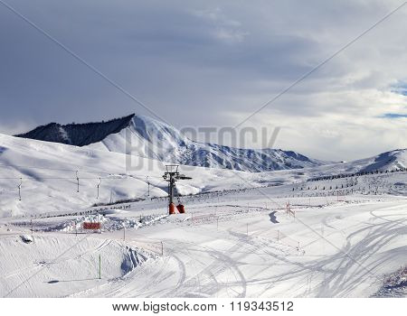 Ski Slope With Surface Lift And Gray Sky