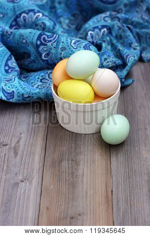 Colored Eggs For Easter On A Wooden Table.