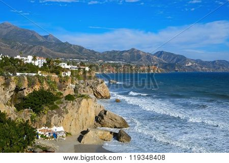 a view of the northern coast of Nerja, at the Mediterranean sea, in the Costa del Sol, Spain, with the Calahonda beach in the foreground