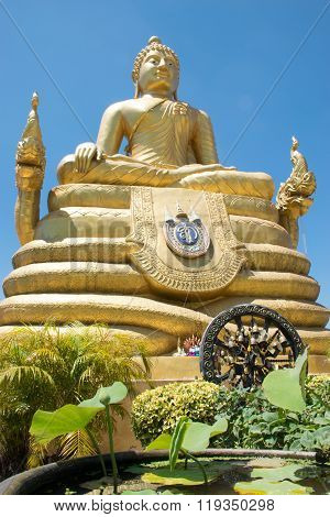 Bronze statue of Bhudda with blue sky