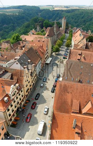 ROTHENBURG OB DER TAUBER GERMANY - AUGUST 10, 2015: Aerial view of Herrngasse street in Rothenburg ob der Tauber from the Town Hall Tower in Germany. It is one of the best-preserved medieval towns in Europe.