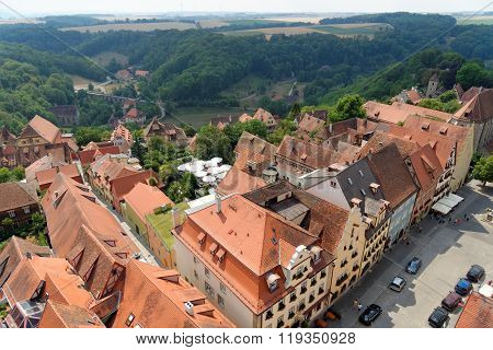 ROTHENBURG OB DER TAUBER GERMANY - AUGUST 10, 2015: Aerial view of Rothenburg ob der Tauber from the Town Hall Tower in Bavaria Germany. It is one of the best-preserved medieval towns in Europe part of the famous Romantic Road tourist route.